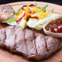 Grilled beef steak with salad served on a wooden board