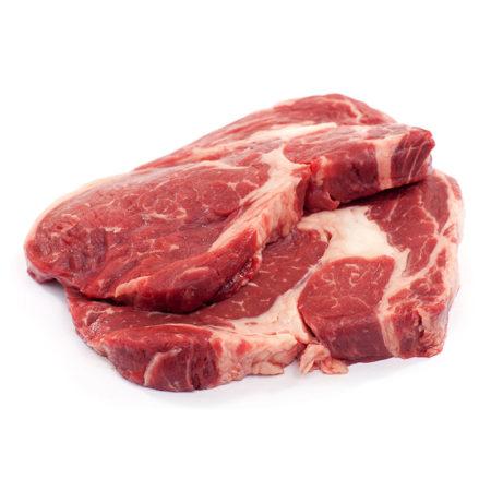 Rib eye steak raw meat against white background